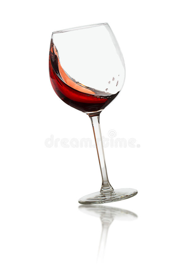 Swirl red wine in glass royalty free stock image