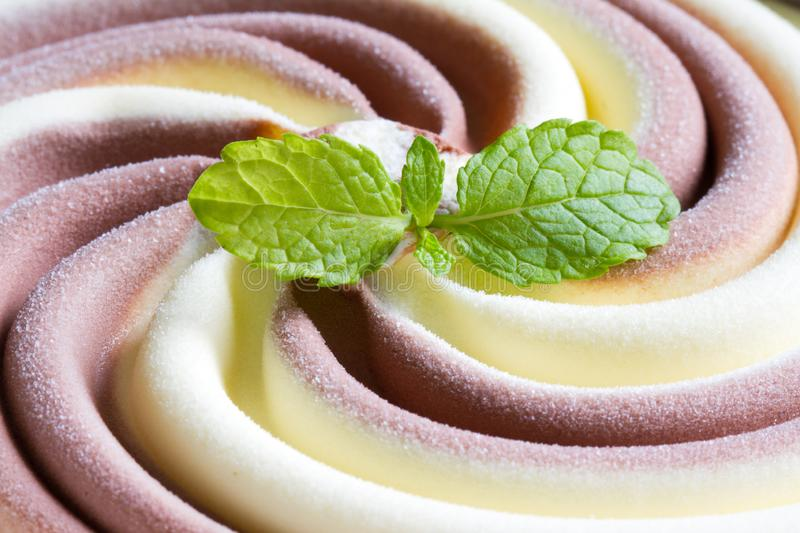 Swirling ice cream with mint abstract background pattern texture. Concept stock image