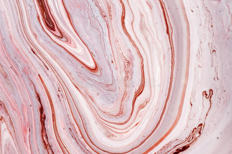 Swirls of marble or the ripples of agate. Liquid marble texture with pink and brown colors. Abstract painting background. For wallpapers, posters, cards stock images