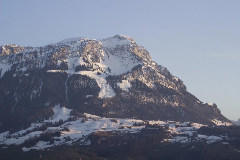 Swiss alp illuminated by sunset stock photo
