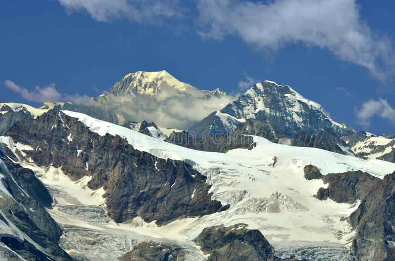 Swiss Alps. Left of centre : the Grand Combin, Right Mont Colon and the Pigne d'Arolla. In the foreground the Tete Blanche (c) and the Tete de Valpelline (r). In royalty free stock photos