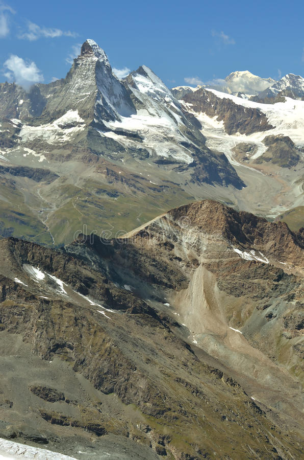 Swiss Alps. Left to Right : Matterhorn, Dent d'Herens, Tete Blanche and the Grand Combin. In the foreground the Oberrothorn, above Zermatt in the southern swiss stock photography