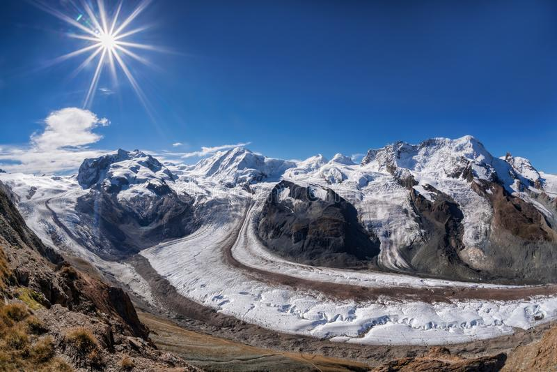 Swiss Alps with glaciers against blue sky, Zermatt area, Switzerland royalty free stock image