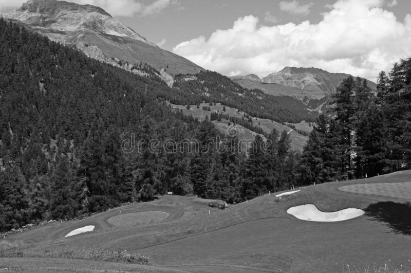 Swiss Alps: The golf-course of the legendary and luxury Kulm Hotel in St. Moritz. But due to Corona Covid19 virus there are no visitors anymore stock photography