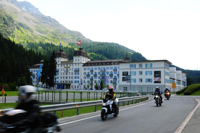 Swiss Alps: The Grand Hotel Kempinski des Baigns in St. Moritz. Swiss Alps: Moped-tour from the Grand Hotel Kempinski des Baigns in St. Moritz in the upper stock photo