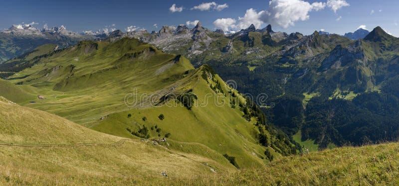 Swiss Alps - Green valley - panoramic view. Panoramic view from Klingerstock in Swiss Canton - Schwyz Switzerland - Swiss Alp royalty free stock photo