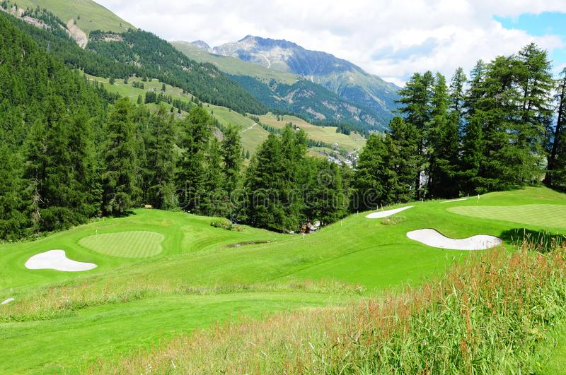 Swiss alps: The Kulm Hotel 9 hole golf course in St. Moritz in the upper Engadin royalty free stock photos