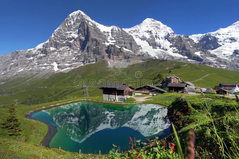 Swiss Alps Landscape. Landscape with Eiger, Moench and part of Jungfrau (to the right), in the Swiss Alps (Bernese Alps) reflecting in a pond at Kleine Scheidegg