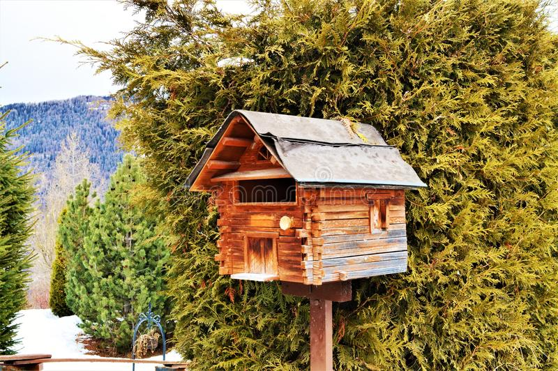 Swiss Alps and mail box. A wooden mail box in the Swiss Alps which are high peaks, famous and touristic range of mountains in Switzerland. Beautiful serene royalty free stock image