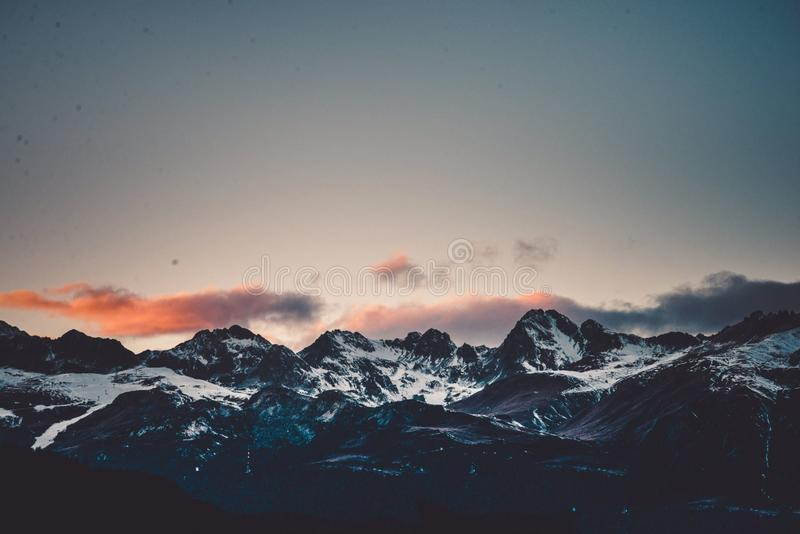 The Swiss Alps, Mountains at Sunset. The Swiss Alps are home to some of the most dramatic scenery in the world. From mountain tops that's height will royalty free stock images