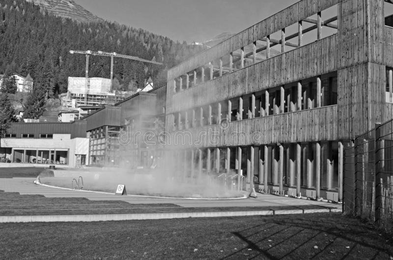 Swiss Alps: outdoor swimming pool of the public bath in the sport-arena of Davos. Swiss Alps: outdoor swimming pool of the public bath in the sport arena of stock photography