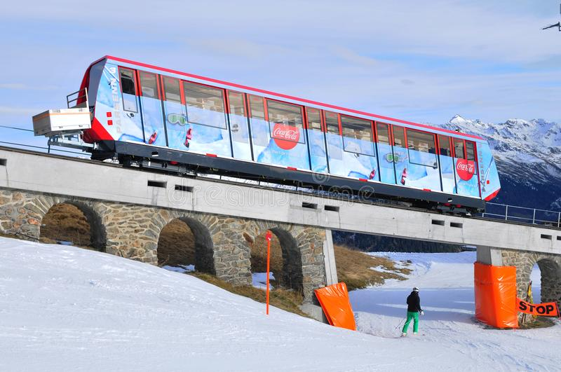 Swiss alps: The Parsenn mountain railway in Davos City. For wintersport and tourism royalty free stock photography