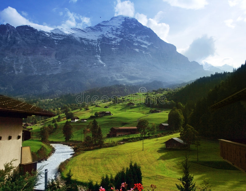 Swiss Alps in spring time. Swiss Alpine hills in Grindelwald royalty free stock photography