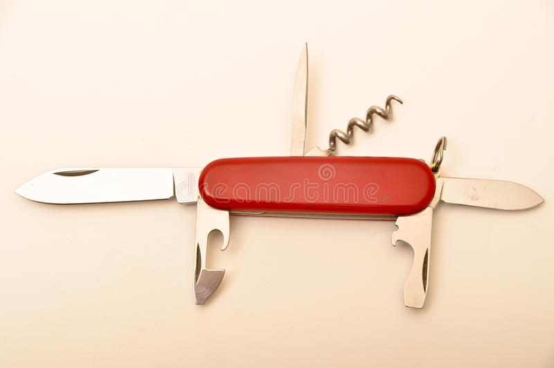 Swiss army knife multipurpose. Multi-purpose Swiss army knife with red handle isolated on white background stock photography