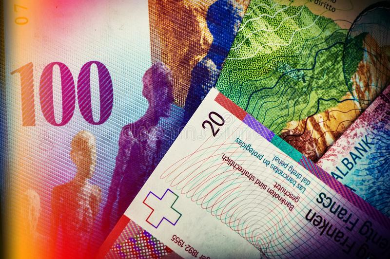 Swiss bank notes are one hundred, ten, twenty francs. stock image