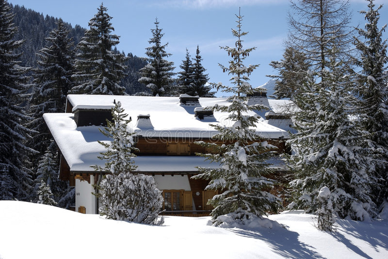 Swiss chalet in winter royalty free stock photos