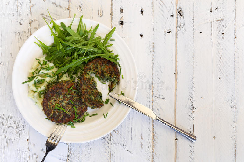Swiss Chard Veggie Fritters with Mash Potatoes and Rocket Leaves stock photography