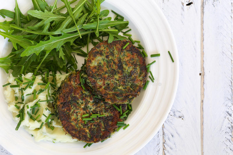 Swiss Chard Veggie Fritters with Mash Potatoes and Rocket Leaves royalty free stock image