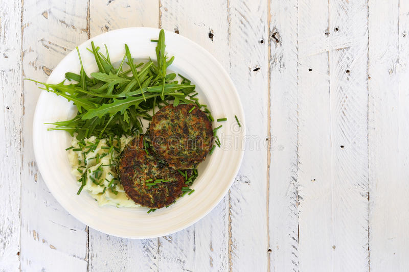 Swiss Chard Veggie Fritters with Mash Potatoes and Rocket Leaves royalty free stock photography