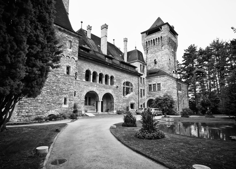 Swiss chateau. Impressive architecture of a Swiss Chateau, the path leading to the impressive building royalty free stock image