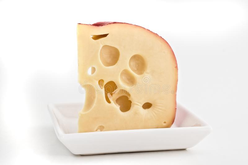 Swiss cheese isolated royalty free stock image