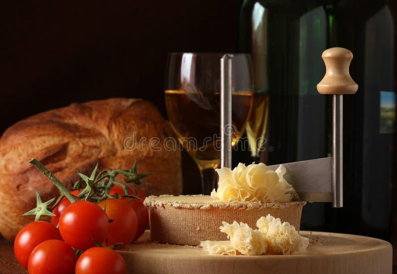 Swiss Cheese Specialty Tete de Moine. Retro Still life of Swiss Cheese Specialty Tete de Moine in low key tone royalty free stock image