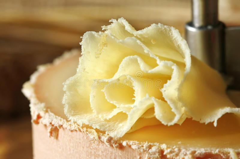 Swiss cheese specialty: Tete de Moine. (macro, shallow DOF royalty free stock image