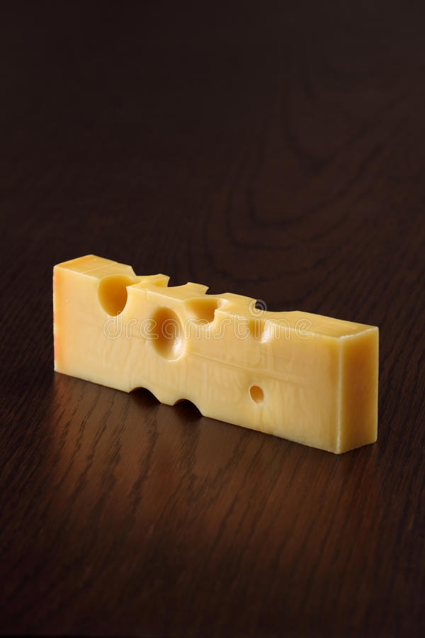 Swiss cheese on a table stock photography