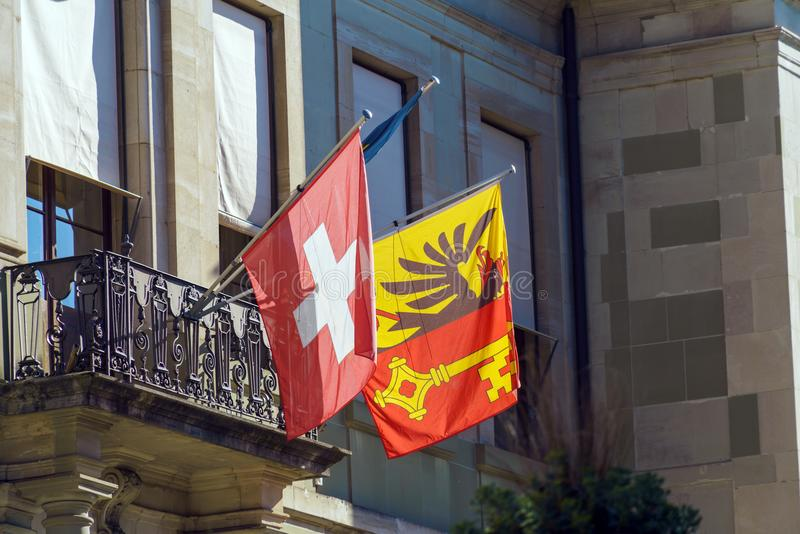 Swiss and city flags with coat of arms, Geneva, Switzerland stock images