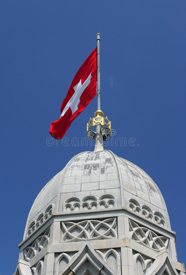 Swiss flag. On top of Grossmunster tower, Zurich, Switzerland royalty free stock image