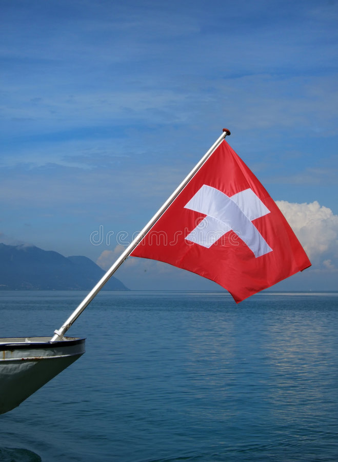 Swiss flag. The red swiss flag on Geneva lake stock photos