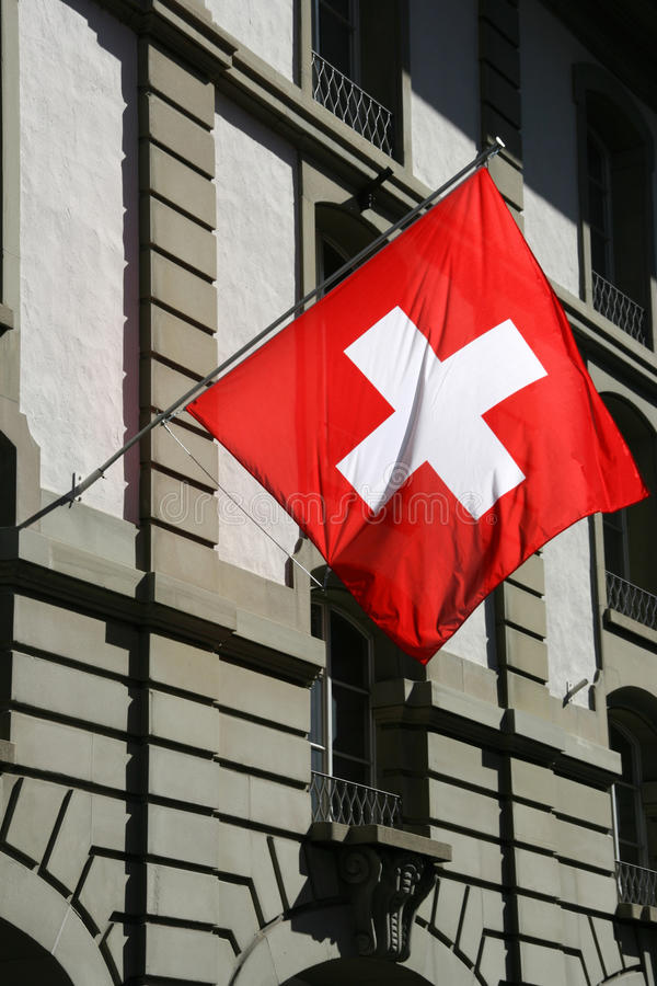 Swiss flag. In Berne, Switzerland. Old town street stock images