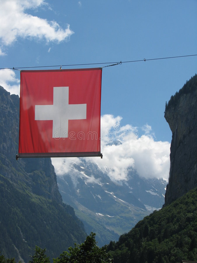 Swiss flag in the Alps. Swiss flag and mountains in Lauterbrunnen - the Alps stock images