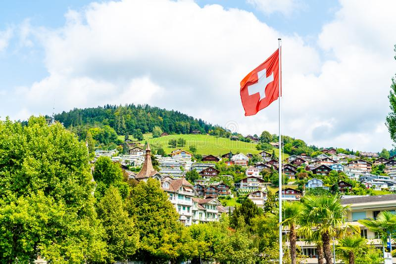 Swiss flag with blue sky. And city royalty free stock images