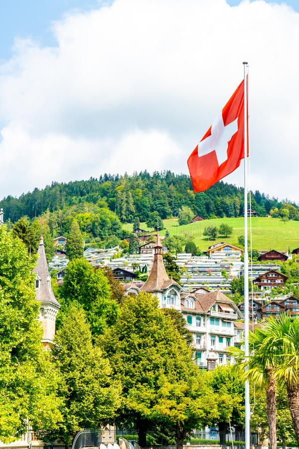 Swiss flag with blue sky. And city stock images