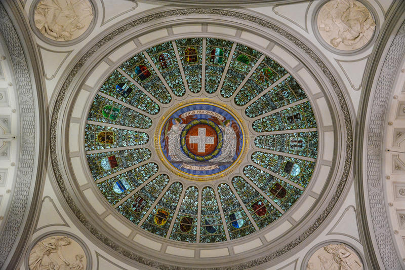 The Swiss Flag and emblems of all cantons of Switzerland in the. The Swiss Flag and emblems of all cantons of Switzerland on the ceiling in the `Bundeshaus` in royalty free stock images