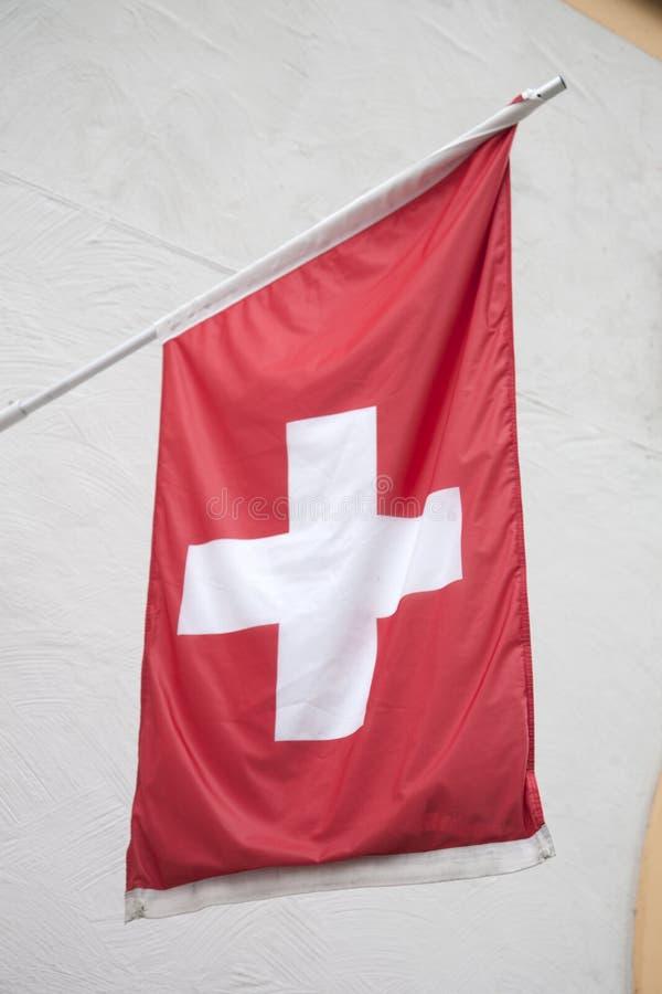 Swiss Flag. Hanging in Street stock photos