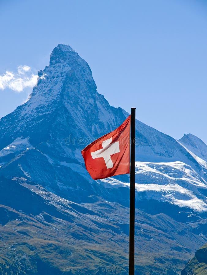 Swiss flag with the Matterhorn. The swiss flag with the Matterhorn in the back stock photography