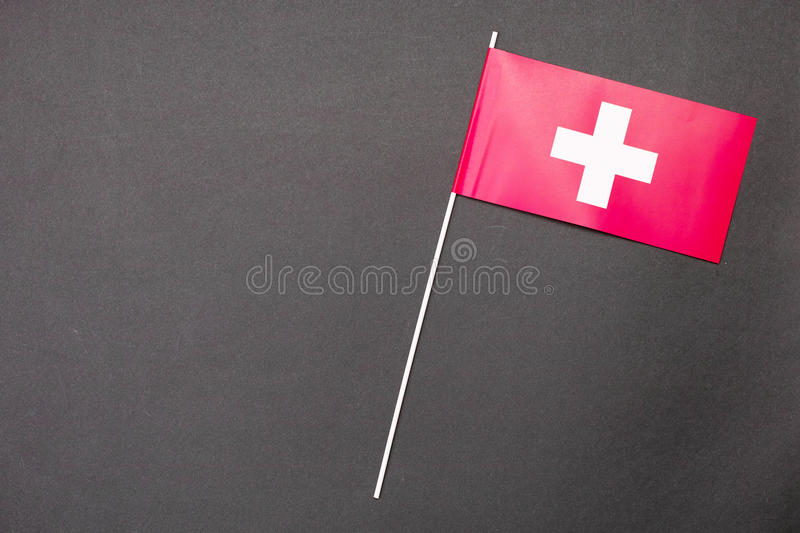 Swiss flag. Small Swiss flag with copy space to the left for anything Swiss related stock photos