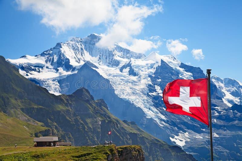 Swiss flag. On the top of Mannlichen (Jungfrau region, Bern, Switzerland stock photography