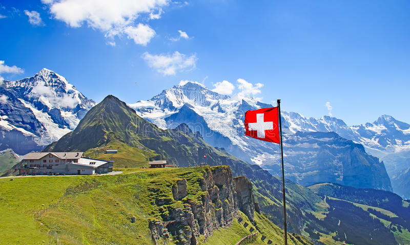 Swiss flag. On the top of Mannlichen (Jungfrau region, Bern, Switzerland royalty free stock photo