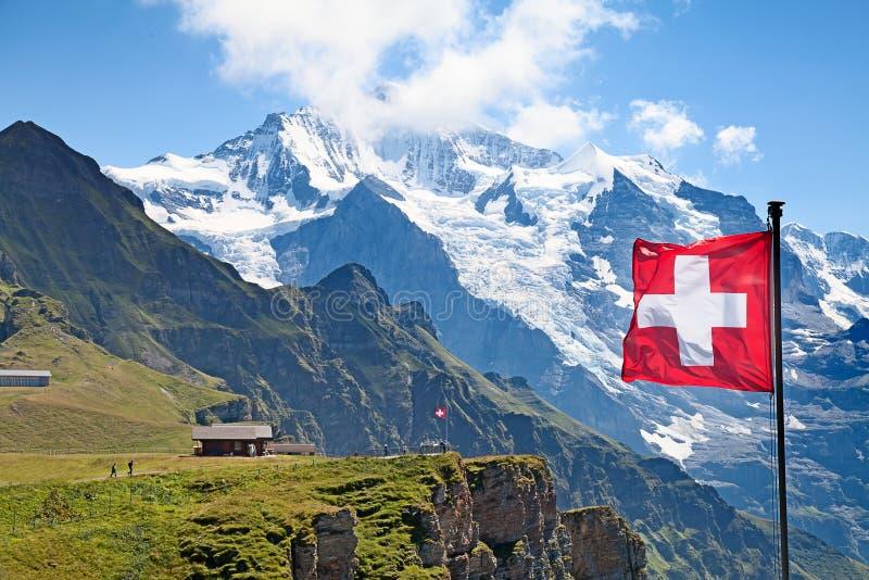 Swiss flag. On the top of Mannlichen (Jungfrau region, Bern, Switzerland stock photos