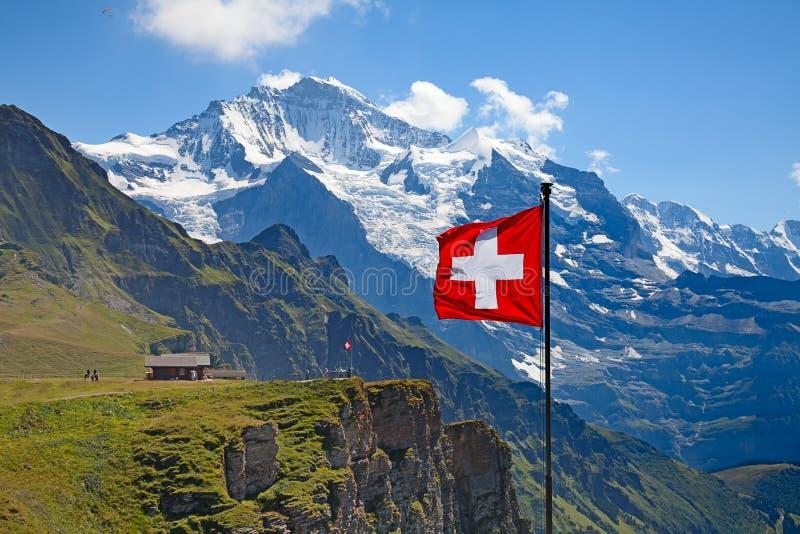 Swiss flag. On the top of Mannlichen (Jungfrau region, Bern, Switzerland stock photo
