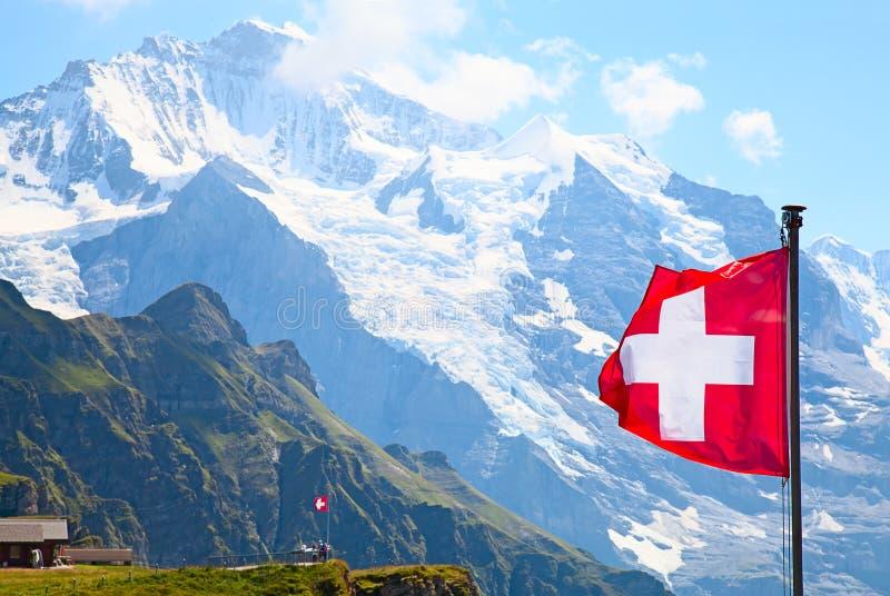 Swiss flag. On the top of Mannlichen (Jungfrau region, Bern, Switzerland stock images