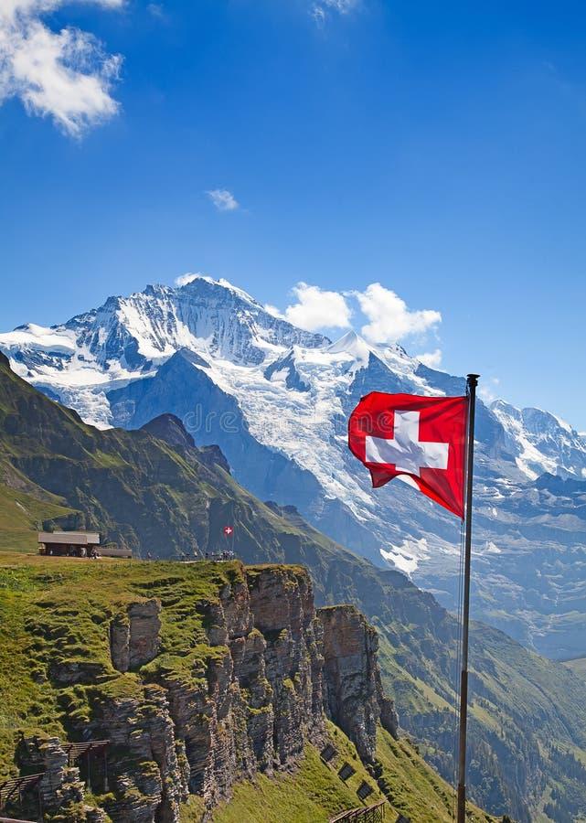 Swiss flag. On the top of Mannlichen (Jungfrau region, Bern, Switzerland royalty free stock image