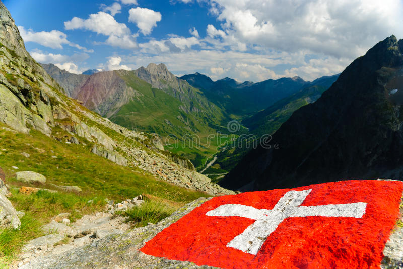 Swiss flag with Val Ferret valley in Switzerland royalty free stock photography