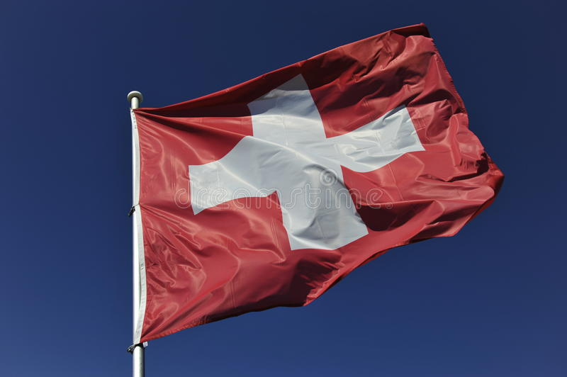 Swiss Flag. Waving in the wind royalty free stock image