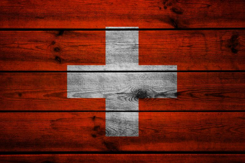 Swiss flag on a wooden background royalty free stock photo
