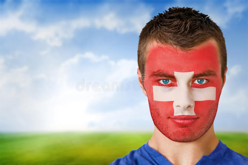Swiss football fan in face paint royalty free stock photography