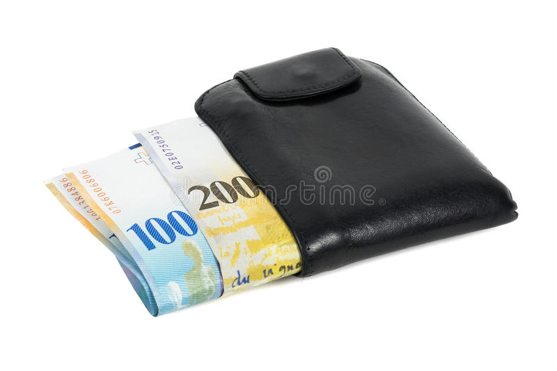 Swiss franc banknotes in black wallet isolated on white royalty free stock photography